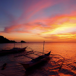 sunset in the Philippines by Fred Goldstein - Landscapes Waterscapes ( clouds, sunset, boats, sea, philippines )