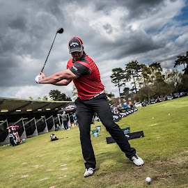 Beast Mode by Simon Talbot-Hurn - Sports & Fitness Golf ( clouds, champion, person, range, sport, belfry, long drive, professional, joe miller, sky, golfer, low pov, drive, pro, golf, power, swing, world champion, man, athlete )