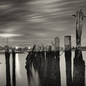 The Abandoned by Chris Mare - Landscapes Waterscapes ( clouds, waterscape, black and white, bar beach, nd, bw, low tide, long exposure, new york, landscape, pilings, skies )