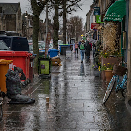 Take Pity On Me by John Finch - City,  Street & Park  Street Scenes ( sidewalk, rainy, street scene, street, beggar )