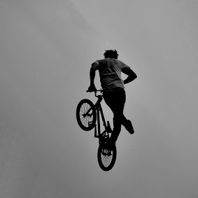 In the air by Adrienn Liker - Sports & Fitness Cycling ( cyclist, black and white, biker, bmx, trick )
