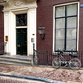 Like Chocolate by Russ Quinlan - City,  Street & Park  Neighborhoods ( door, street, holland, amsterdam, brown, travel, building, bike )