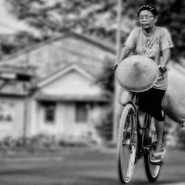 tough woman by Iqbal Gautama - Transportation Bicycles