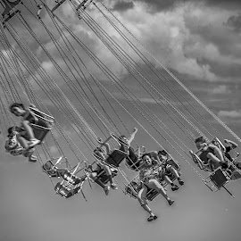 Carousel by Péter Mocsonoky - People Group/Corporate ( ride, swinging, joy, round, circle, people, attraction, child, funfair, sky, action, spin, carousel, motion, swing, turn, park, carnival, vintage, play, happiness, leisure, kids, fun, fair, entertainment, fly, chain, amusement, summer, high )