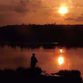 fisherman by Libuše Kludská - Landscapes Waterscapes