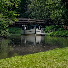 Idle Times by Don Kuhnle - Transportation Boats ( isaac ludwig mill, mules, reflections, canal, riverboat, park )