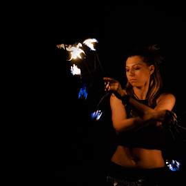Strike a Pose by Vinod Kalathil - People Musicians & Entertainers ( woman, night, chicago, dance, entertainer, fire )