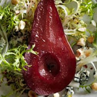 Frisée Salad with Shiraz-Poached Pears, Roquefort, and Hazelnuts