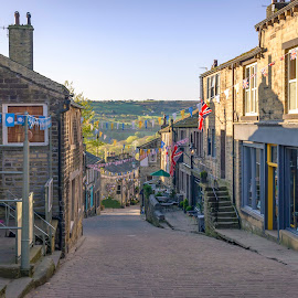 Haworth by Darrell Evans - City,  Street & Park  Historic Districts ( shop, hamlet, tourism, house, building, path, signs, cobblestone, bronte, road, uk, street, village, picturesque, historic, business, town, yorkshire, old, bunting, cobbles, walkway, worth valley, windows, home, stone, outdoor, hill, urban, haworth )