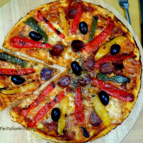 Spicy Pizza With Peppers And Salami