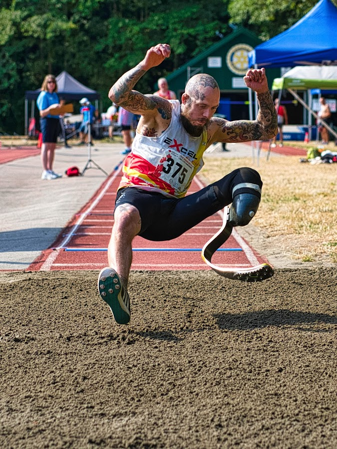 Gravity Prevails by Garry Dosa - Sports & Fitness Other Sports ( air borne, sports, jumping, long jump, outdoors, person, games, track and field, athletes, man, people, male )