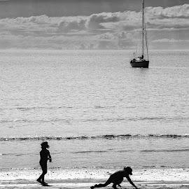 Beach Play by Mick Glass - People Family ( calm, water, black and white, children, beach, boat, KidsOfSummer )
