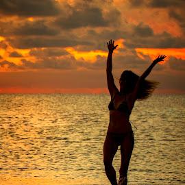 Summertime Fun by Troy Wheatley - People Street & Candids ( water, splash, sunset, silhouette, woman )