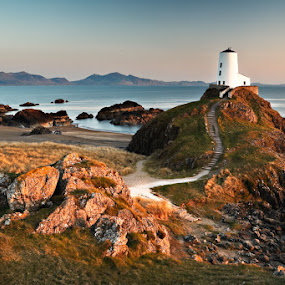 Path to the Lighthouse by Pete Barnes - Landscapes Beaches ( calm, north wales, anglesey, landscape photographer, ocean, landscape, sun, photography, sky, nature, llanddwyn, photographer, dramatic, path, sail, rocks, art, beautiful, lighthouse, sea, leisure, steps, scenic, sunset, outdoors, artistic, cloud, landscape photography, scene, sunrise )