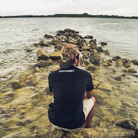 Looking up another world by Ryandika Harditya - People Portraits of Men ( water, men, beach, boy )