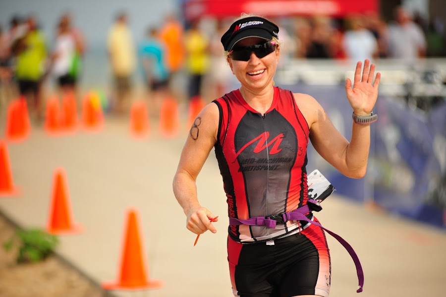 Jill leads the race by Bob Stafford - Sports & Fitness Running ( jill, triathlon, caseville, run, race )