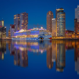 Aida Prima docked at the port of Rotterdam during the blue hour by Rémon Lourier - City,  Street & Park  Skylines