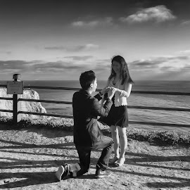 Some moments are nice, some are nicer, some are even worth writing about.    So, she smiled with an ecstatic air and said ... YES! (iphoneography - Iphone 6 series shot) by Tin Tin Abad - People Couples ( black and white, sunset, proposal, lighthouse, ocean, engagement )