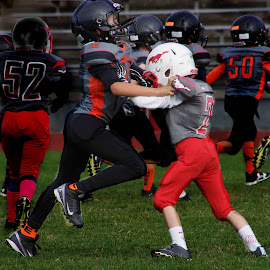 The struggle by Gaylord Mink - Babies & Children Children Candids ( uniforms, football, boys, play, puch )