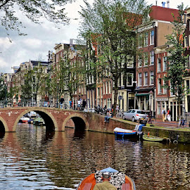 Canal in Amsterdam by Francis Xavier Camilleri - City,  Street & Park  Street Scenes ( reflections, trees, amsterdam, bridge, architecture, boat, canal, netherlands )