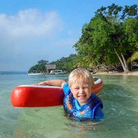 In The Tropics by Geoffrey Wols - Babies & Children Toddlers ( child, water, vanuatu, tropical, paddle board, beach, boy )