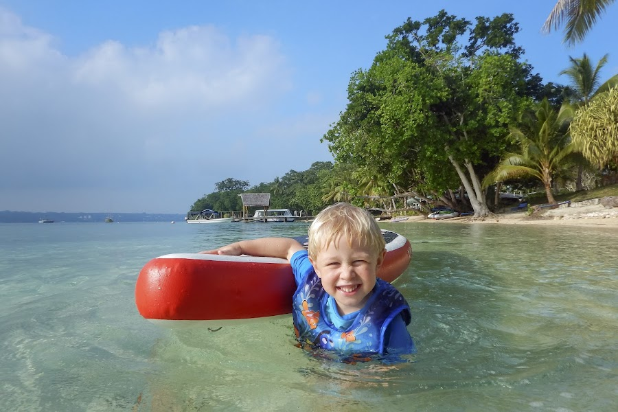 In The Tropics by Geoffrey Wols - Babies & Children Toddlers ( child, water, vanuatu, tropical, paddle board, beach, boy,  )