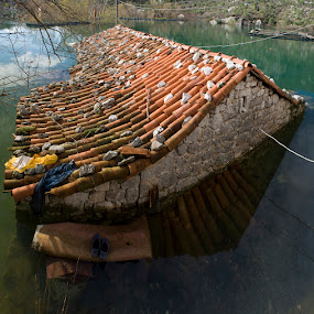 The Shoes by Dejan Dajković - News & Events World Events ( water, shoes, roof, flood, house )
