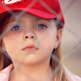 Intense by Jeannie Meyer - Babies & Children Child Portraits ( canon, fence, little girl, red, 70-200, baseball, blue eyes, pink, serious, league of their own )