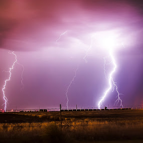 Storm Over Air Base by Glenn Patterson - Landscapes Weather ( clouds, field, fence, lightning, sky, thunderstorm, purple, weather, weeds, storm )