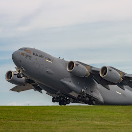 NEW WINDSOR, NY - SEPTEMBER 3, 2016: Giant C-17 Globemaster III  by Jan Gorzynik - Transportation Airplanes ( interior, c-17, spectators, iii, cargo, swf, airport, stewart, american, guard, runway, york, four, windsor, grass, globemaster, engines, international, number, airplae, gray, tail, huge, new, flag, plane, air )