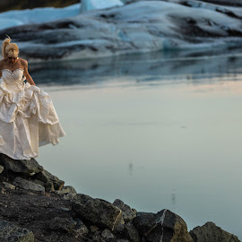 Women in dress-2 by Edvald Geirsson - People Fashion ( woman, jökulsárlón, glasier, iceland, dress up, sea )