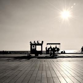 silhouettes by Andreas Batzilis - City,  Street & Park  Street Scenes ( port, park, silhouette, street, pop corn, people, sun, city, stroll, sunny, summer, people sunday, walk )