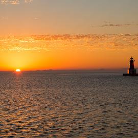 Menominee Lighthouse by John Kehoe - Landscapes Sunsets & Sunrises ( michigan, bay, light house, lighthouse, cloud, sunrise, menominee, sun, river )