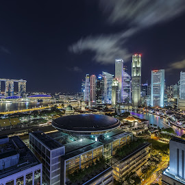 Singapore Cityscape by Freddy Ng - City,  Street & Park  Night ( cityscapes, nighttime in the city, skyscrapers, night life, blue hour, park at night, street at night, long exposure, moving clouds, city at night, singapore, nightlife )