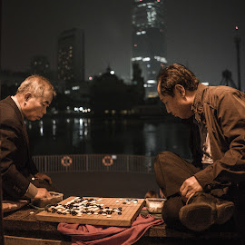 Playing Chess 2 by Varok Saurfang - People Street & Candids ( old, park, seoul, chess, night, people, go )