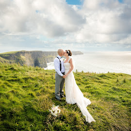 Love on the Rocks by Paul Duane - Wedding Bride & Groom ( cliffsofmoher, ireland, cliffs, eloped, wedding, elopement, wedding photographer, bride and groom )