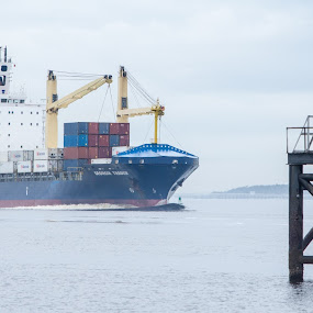 Cargo Ship Coming Down The River by Thomas Shaw - Transportation Boats ( clouds, water, cranes, sky, waves, cape fear, ships, boat, cargo, north carolina, cape fear river, river )