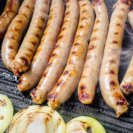 Sausages by Yancho Zapryanov - Food & Drink Meats & Cheeses ( nobody, bratwurst, grill, frypan, catering, breakfast, cooked, heat, close, sausage, fresh, meat, cooking, bbq, grilled, closeup, gourmet, cookery, spicy, close-up, pan, dinner, red, food, pork, hot, fry, fast, barbecue, grilling, picnic )