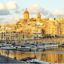 Vittoriosa during golden hour by Francis Xavier Camilleri - City,  Street & Park  Historic Districts ( reflection, church, boats, sea, architecture, golden hour )