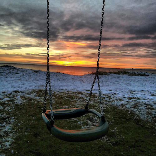 Shall we swing? by Julija Moroza Broberg - Backgrounds Holiday ( water, clouds, holiday, playground, sky, red, sunset, object, swing )