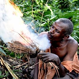 A Fire Maker. by Marcel Cintalan - People Portraits of Men ( face, fire, jungle, man, uganda, people )