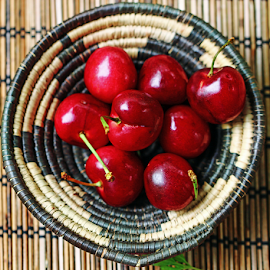 Cherries in a basket. by Dipali S - Food & Drink Fruits & Vegetables ( raw, juicy, diet, drop, leaf, berry, vitamins, nature, fresh, juice, calories, jam, dessert, meal, water, fruit, green, beautiful, delicious, health, pie, cherry, tasty, organic, sweet, red, food, ripe, healthy, summer, lot, freshness, garden )