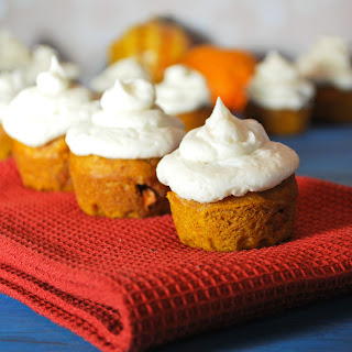 Mini Pumpkin Cupcakes Mixed with Butterscotch and Topped with Cardamom Buttercream Icing
