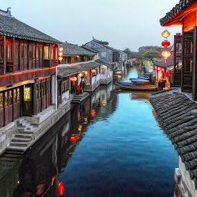The canals in Zhouzhuang by Daniel Schwabe - City,  Street & Park  Neighborhoods ( zhouzhuang, canals, reflection, boats, lamp, shanghai, china )