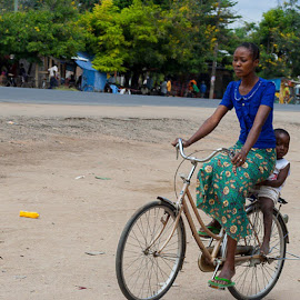 When i travel i get to seefrom a different perspective. This iswhere women have  embraceas a mode oftheirto school and running other errands around. The power of anwoman in display. by David Mutunga - Transportation Bicycles ( life, Tanzania, biking, transporting, kids, African, potD, potdkenya, travel, powerladies, africanwoman, everydayafrica, everydayfoto, capturedinafrica, publicimage, headon15, heroes, hot_shots, kenya360, LightAwards, lifestyle, worldshots, education, streetphotography )