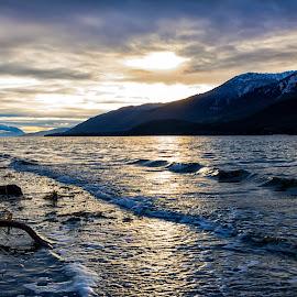 The sun sets over the mountains by Carol Ward - Landscapes Waterscapes ( water, mountains, waterscape, sunsets, alaska, juneau )