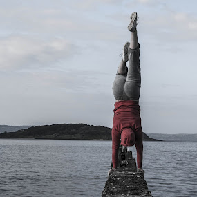 in the deep by Danny Charge - People Street & Candids ( red, sea, fun, handstand, wall )