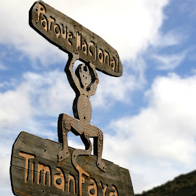 Timanfaya by Martin Burnett - Travel Locations Landmarks ( clouds, wood, devil, sun, iron, spain, sign, holiday, national park, volcano, sky, timanfaya, lanzarote )