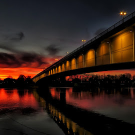 by Milanka Dimic - Buildings & Architecture Bridges & Suspended Structures ( reflection, sunset, bride, river, multicolored )
