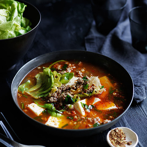 Spicy Sichuan-style soup with pork, lettuce and soft tofu